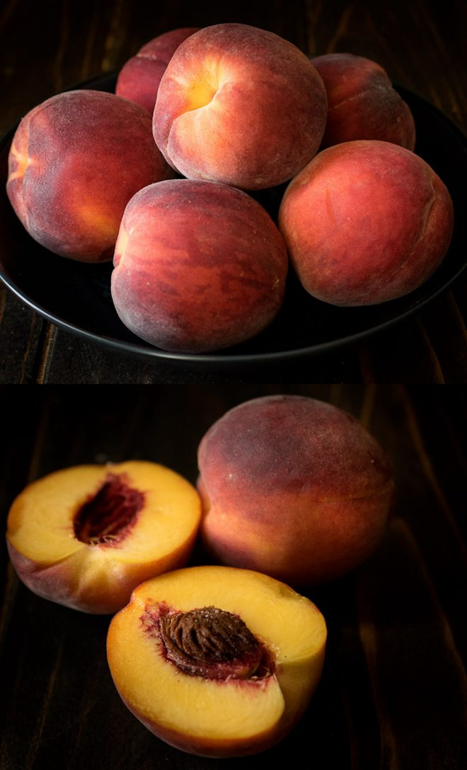 Whole peaches in a bowl and one cut in half