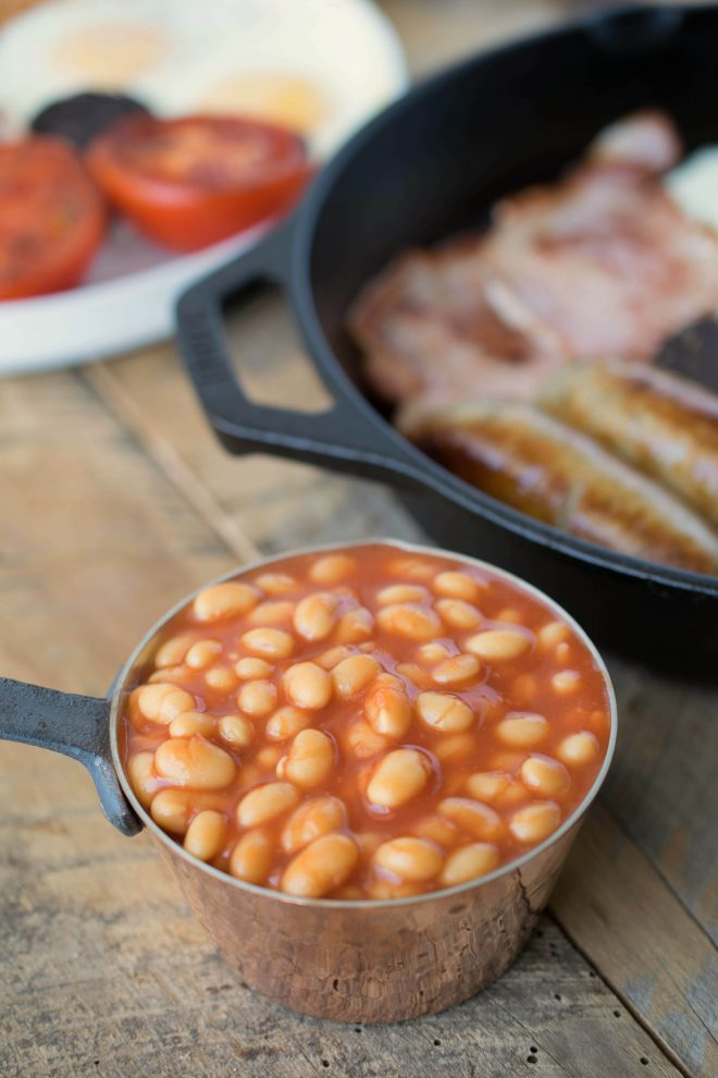 A mini copper pan filled with British baked beans