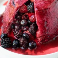 A closeup of the berries inside a bread dome with the berry juices