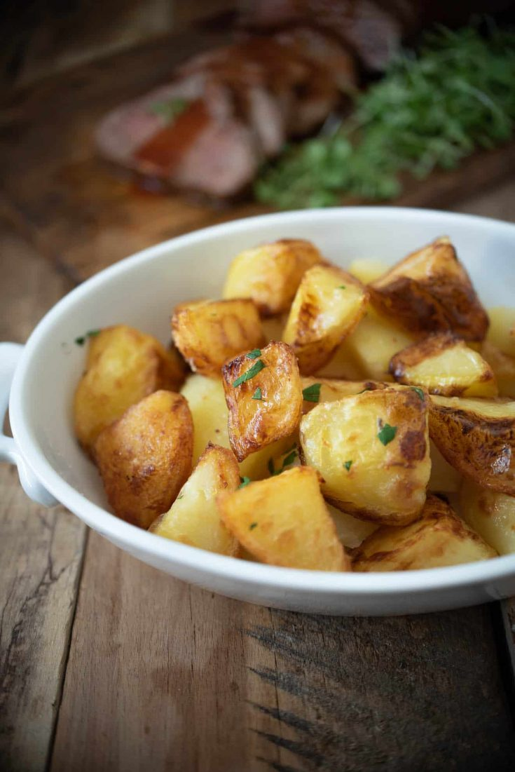 British roast potatoes - roasties fresh out of the oven in a serving dish
