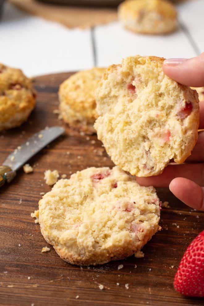 A British Summer Strawberry Scone cut in half showing the soft, fluffy inside