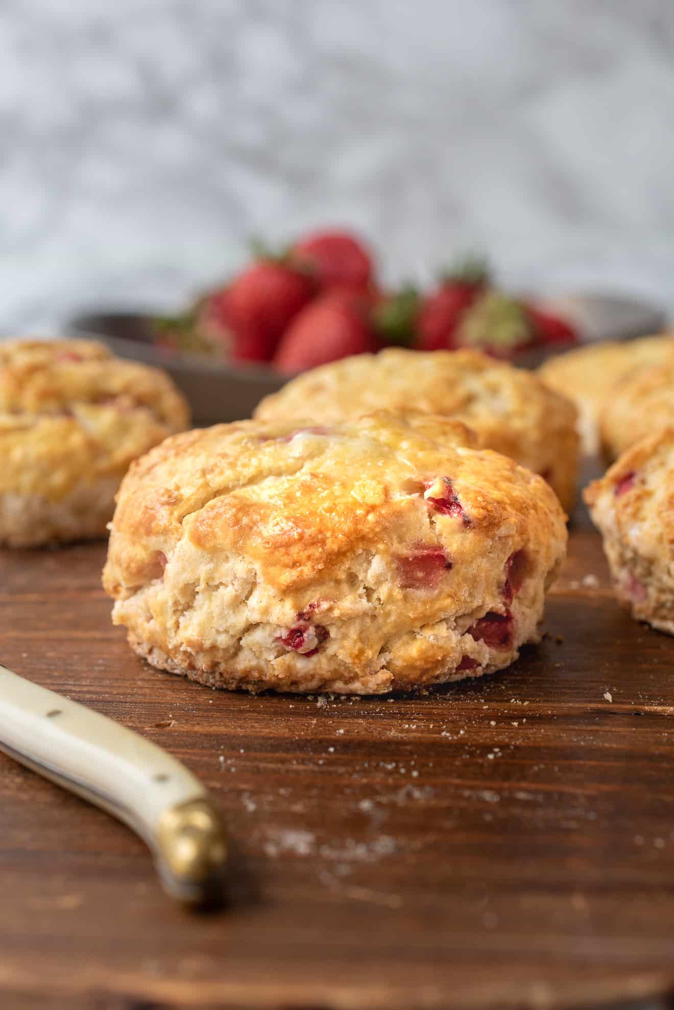 A side view of strawberry scones showing the chunks of fresh strawberries