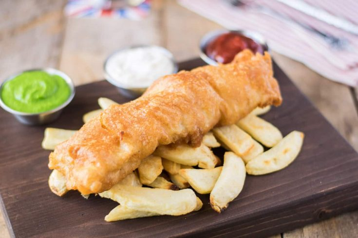 British fish and chips served with peas, ketchup and tartar sauce