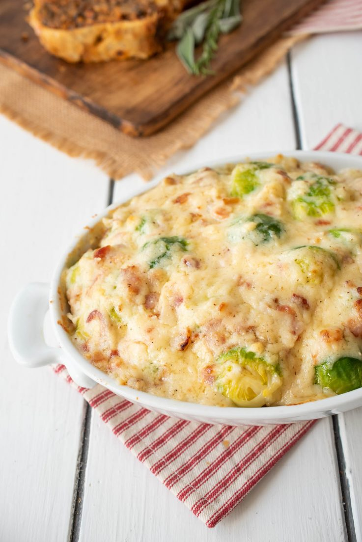 Brussels sprouts covered in a bacon cheese sauce
