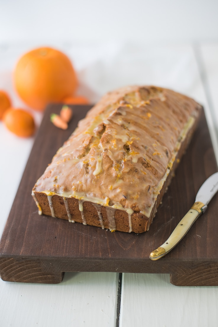 Carrot ginger spiced bread on a board with a knife