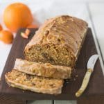 Carrot ginger spiced bread on a cutting board sliced