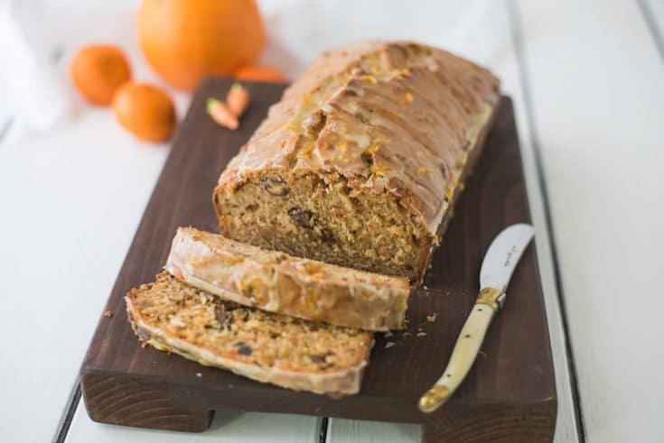 Carrot ginger spiced bread on a board with a knife and slices