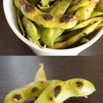 A closeup of edamame with a perfect char with specs of togarashi