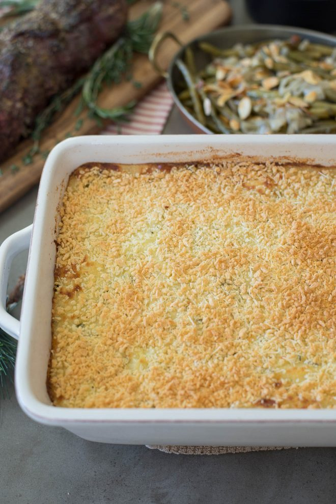 Mashed potato in a casserole dish topped with crispy panko breadcrumbs
