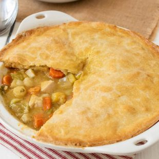 A freshly baked chicken pot pie with winter vegetables