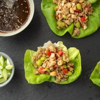 Ground chicken and vegetables in lettuce with orange sauce