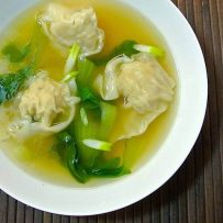 Chicken wonton soup in a white bowl