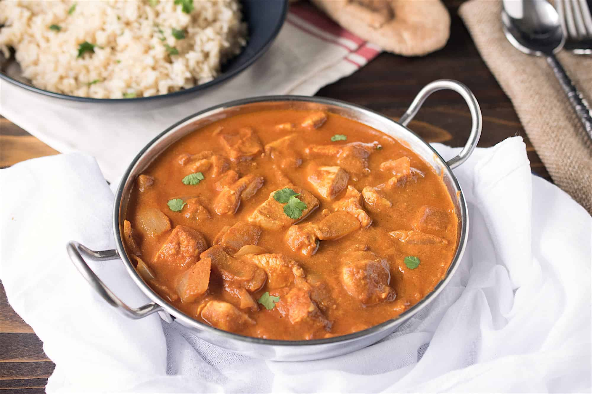 Chicken tikka masala in a tradtional Indian serving bowl