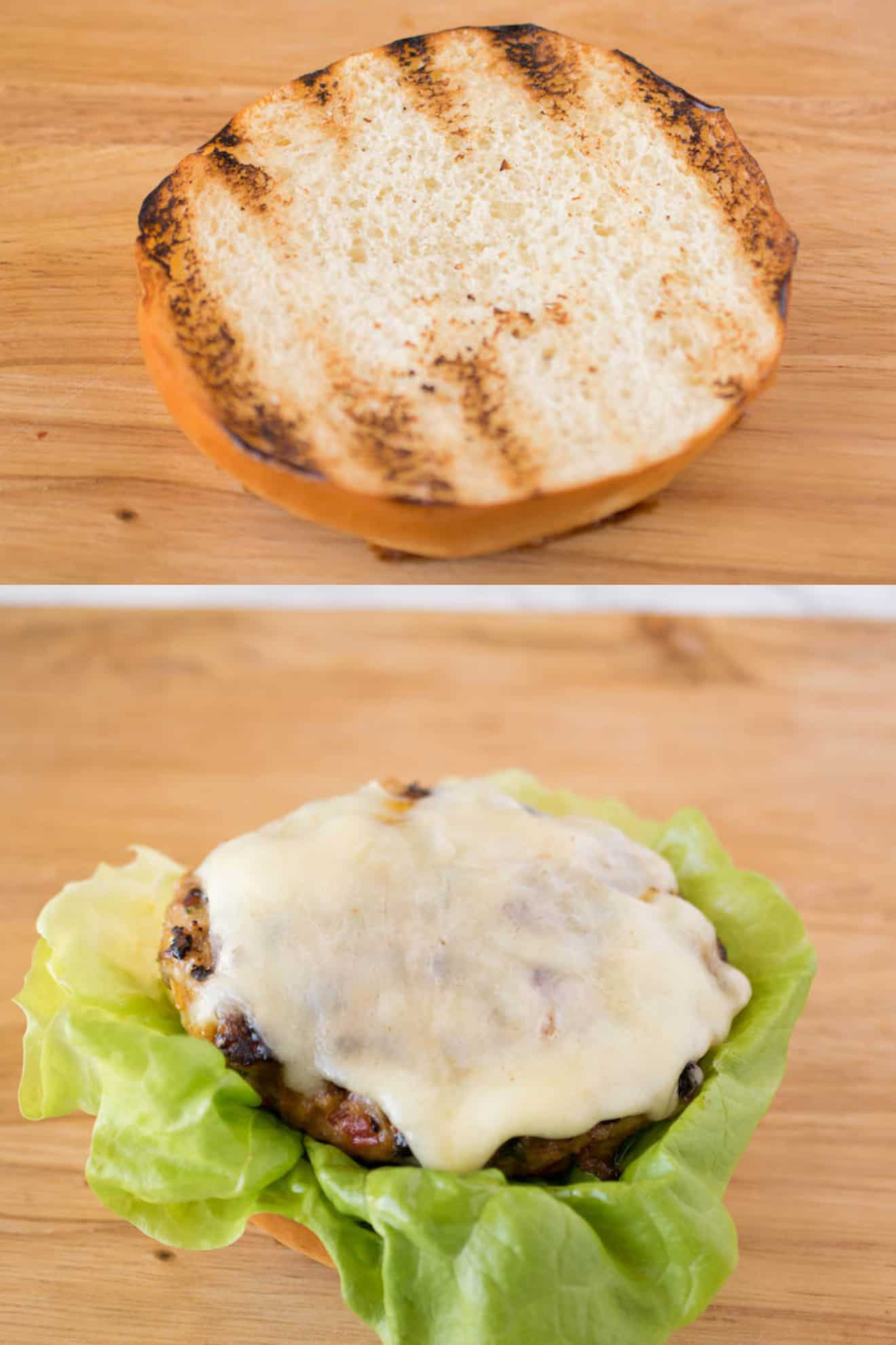 A grilled bun and a burger with melted cheese on lettuce