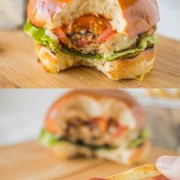 Chipotle chicken burger with a bite taken and dipping a French fry into ketchup