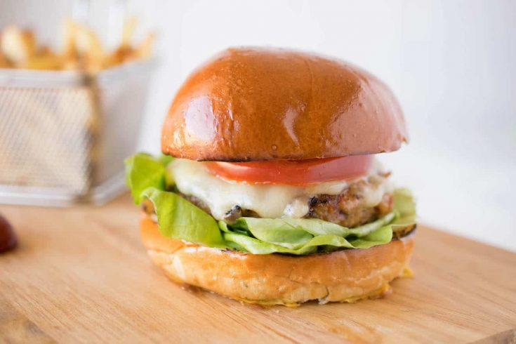 A chipotle chicken burger from the side