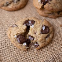 A chocolate chunk cookie pulled apart showing all the chocolate inside