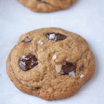 Large flakes of sea salt on top of a chocolate chunk cookie