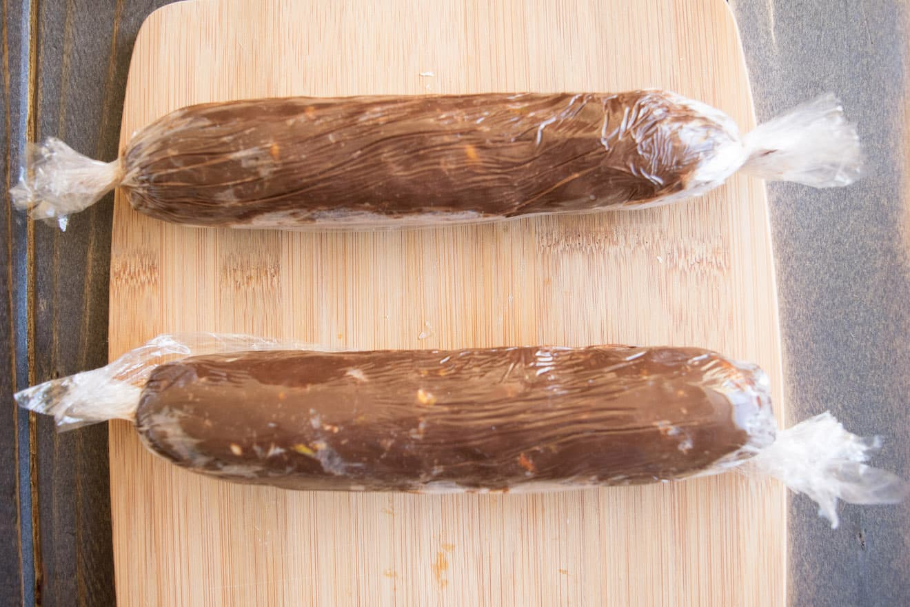 2 chocolate salami wrapped in plastic wrap