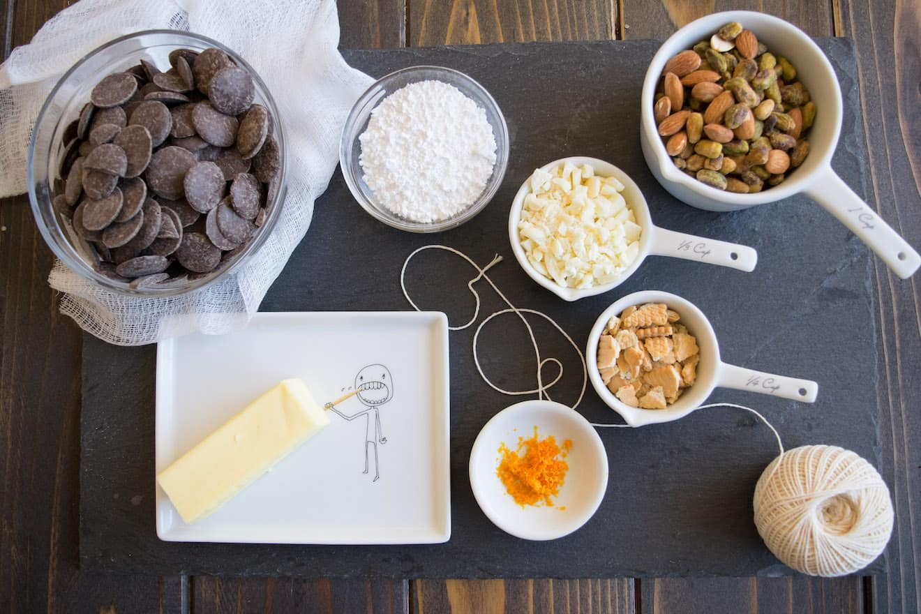 Chocolate chips, nuts, butter and cookies. The ingredients to make chocolate salami