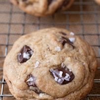 Large chocolate chunks in a cookie topped with flaky sea salt