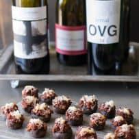Bottles of wine with chorizo stuffed mushrooms