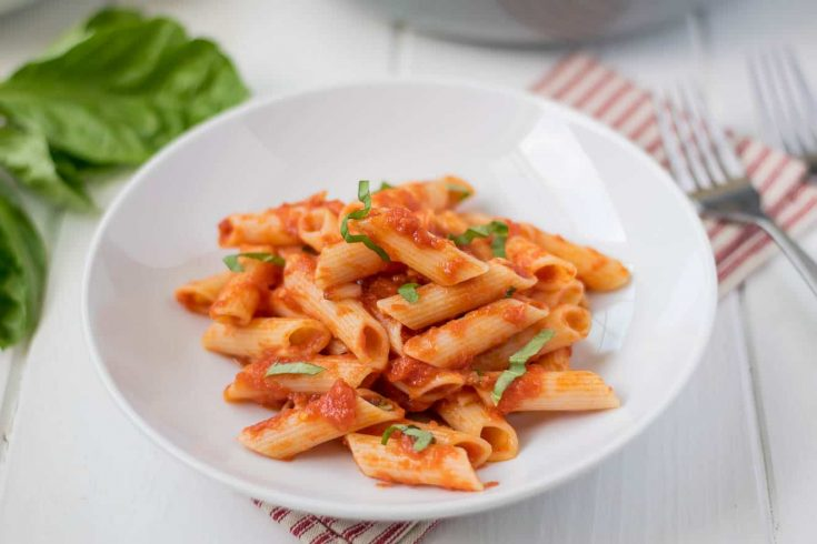 A white bowl filled with penne all'arrabbiata