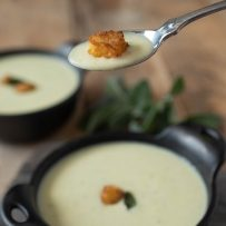 A spoonful of Cornbread, Sage & Onion soup with a cornbread crouton