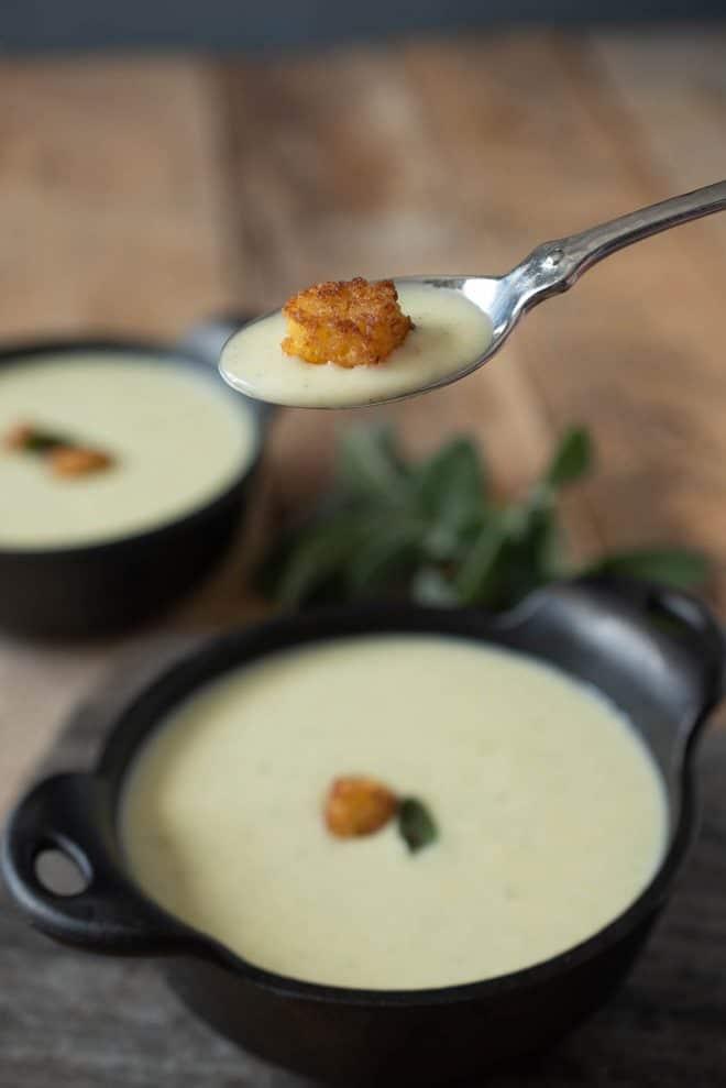 A spoonful of Cornbread, Sage & Onion soup with a cornbread crouton