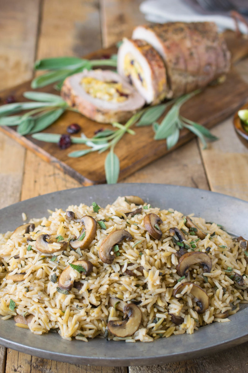 Mushroom sage rice pilaf on a sliver plate is the perfect side dish