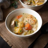 Colorful vegetables in a bowl of Creamy Chicken Stew with Sage and Chive Dumplings