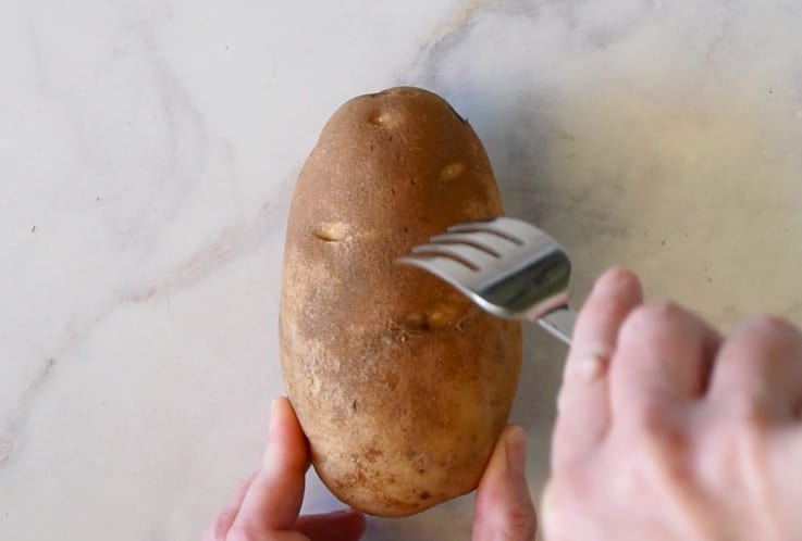 Pierce a potato all over with a fork