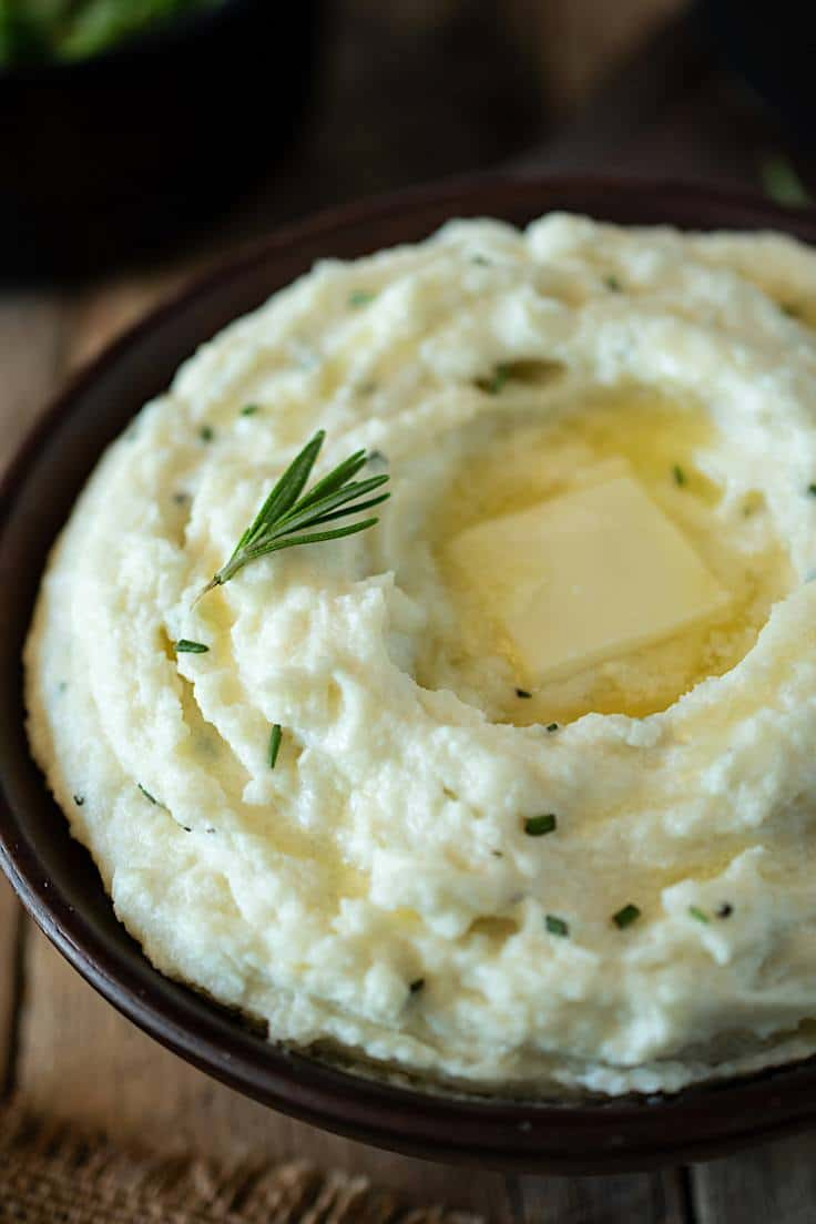 A closeup showing the flecks of rosemary in creamy rosemary cauliflower mash