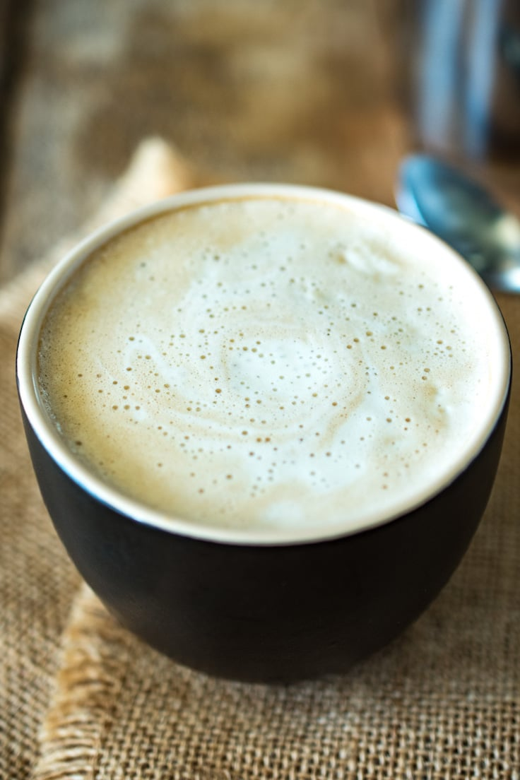 This creamy almond coconut cashew coffee will be your new chilly morning wake-me-up drink that is dairy free. Healthy almond milk is blended and thickened with coconut oil, cashews and a little honey for a creamy coffee creamer. This is Bulletproof coffee meets healthy latte.