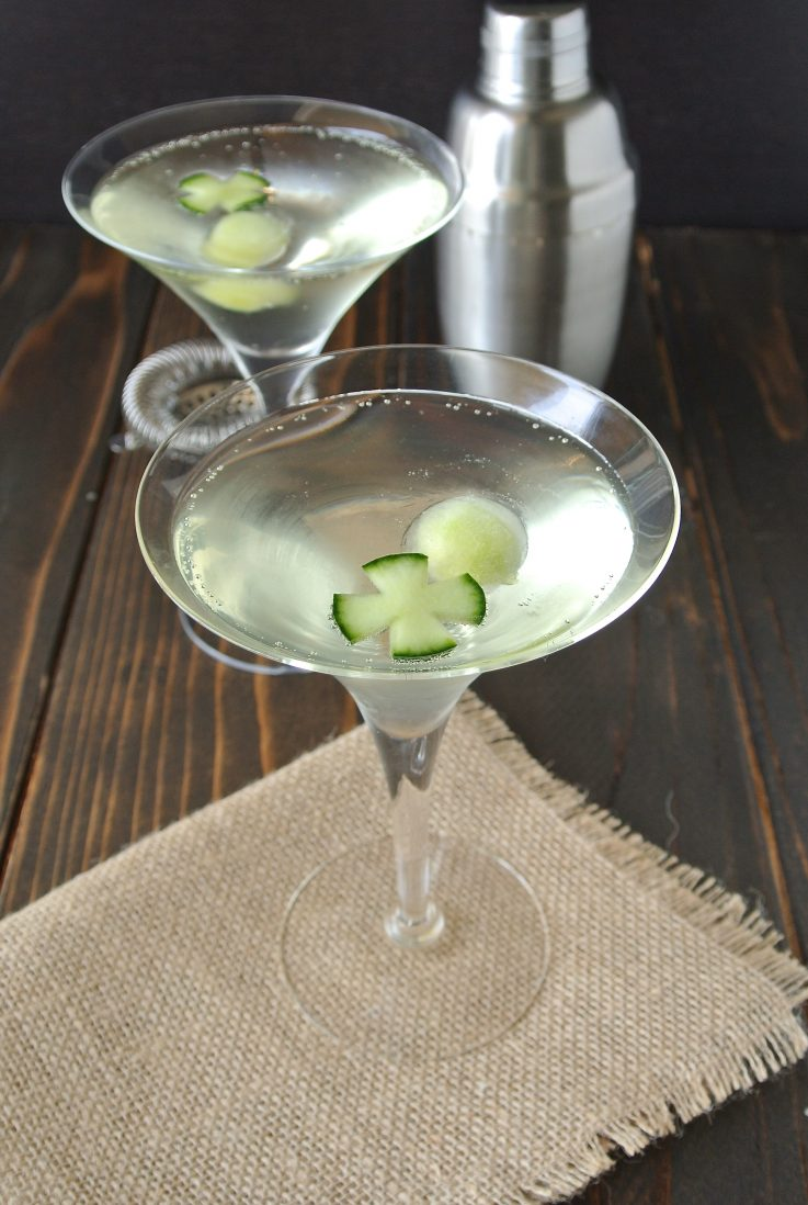 2 martini glasses of cucumber gin fizz garnished with cucumber