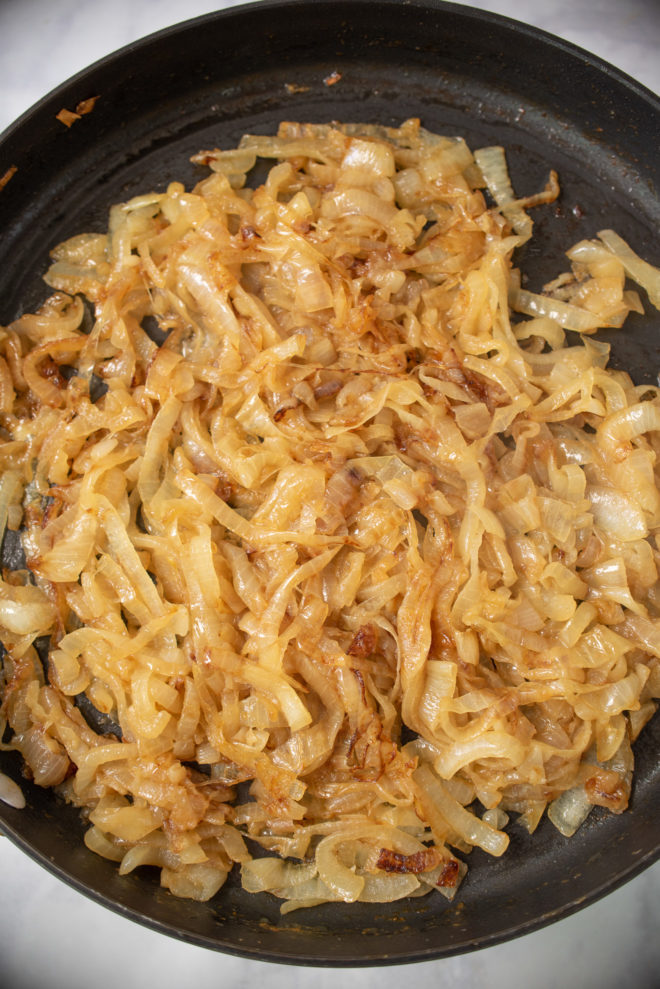 Brown, caramelized onions in a pan