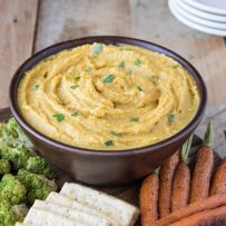 Curry roasted butternut squash and apple dip isa delicious coming together of two seasonal fruits and vegetables. Perfect for fall entertaining and served at room temperature with baked pita chips, roasted veggies or crackers.