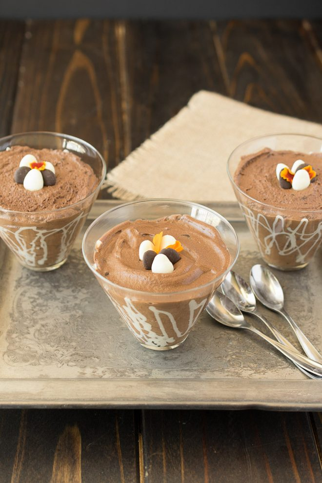 3 glass bowls of dark chocolate espresso mousse with 3 spoons