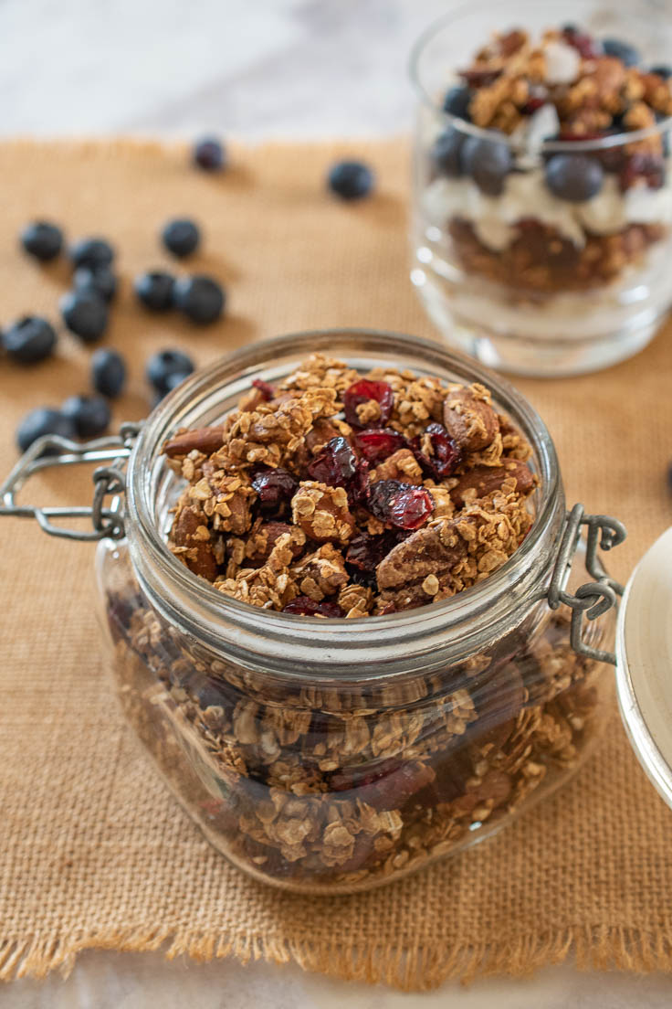 Granola in a jar topped with dried cranberries