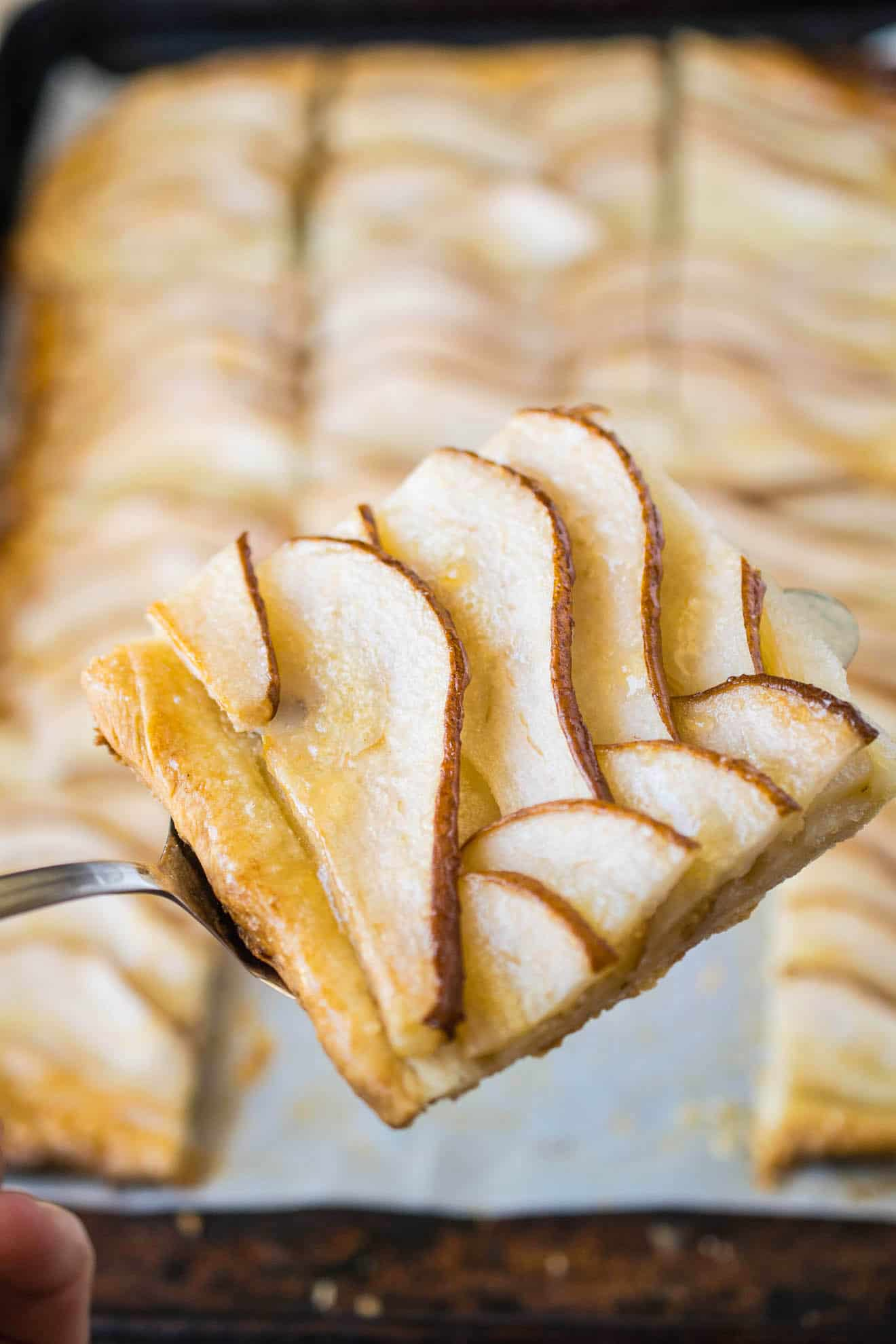 A closeup of a pear tart slice
