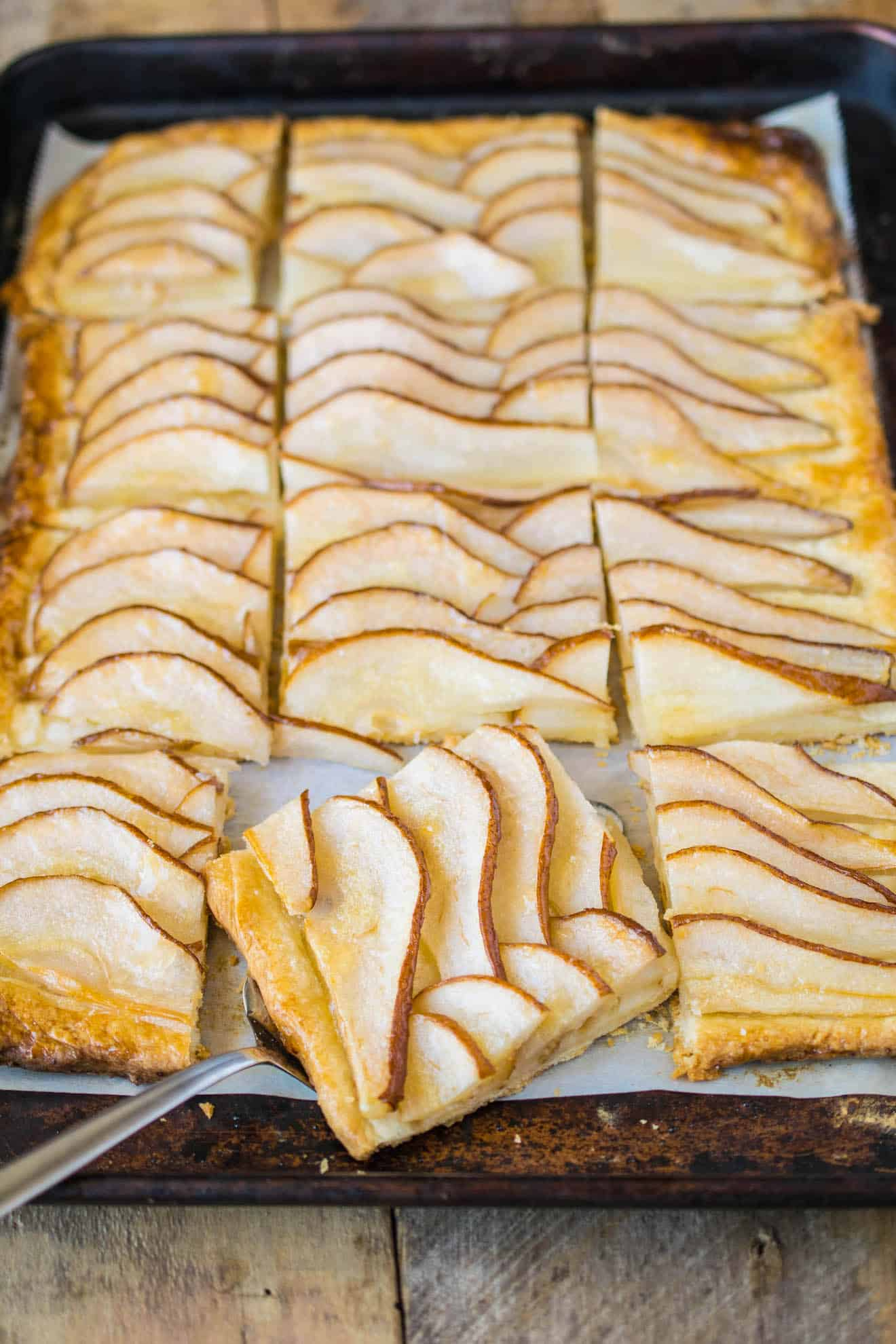 Pear slices laid out on a tart
