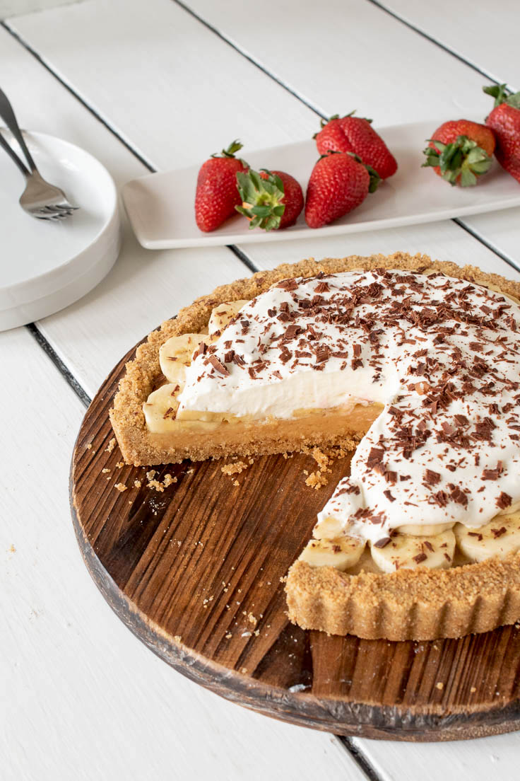 Banoffee pie with a slice cut showing the filling