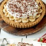 A whole Banoffee pie and a slice on a cake server