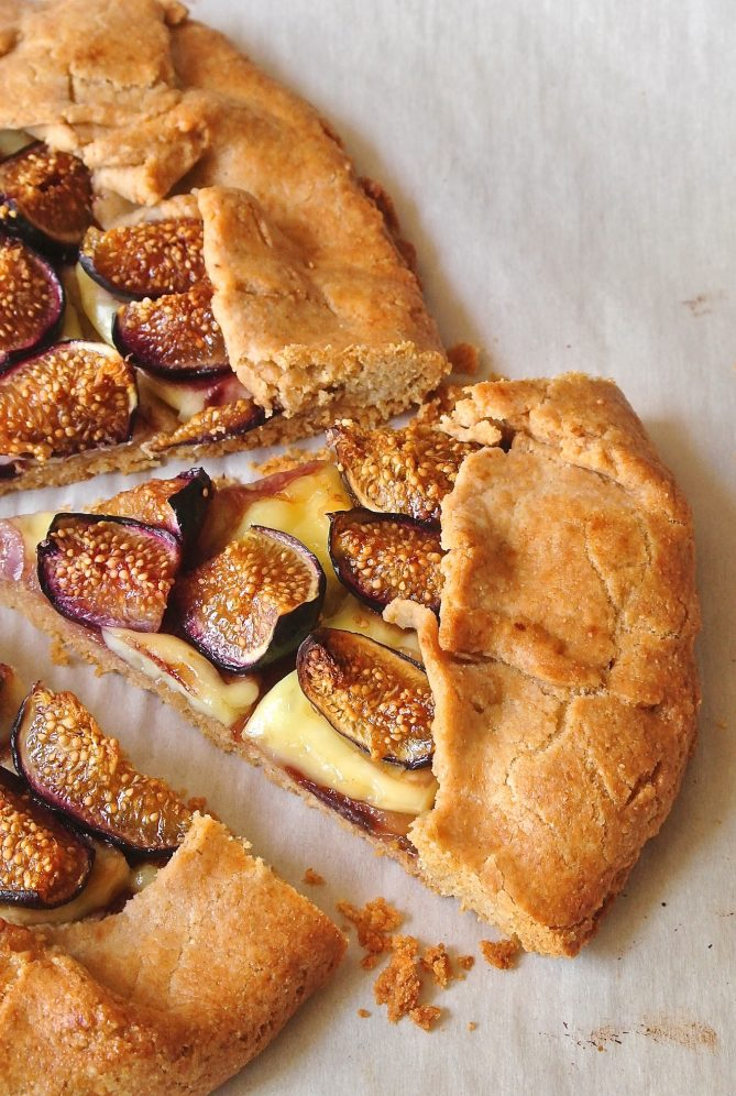 Flaky pastry galette with a filling of brie and fresh fig wedges