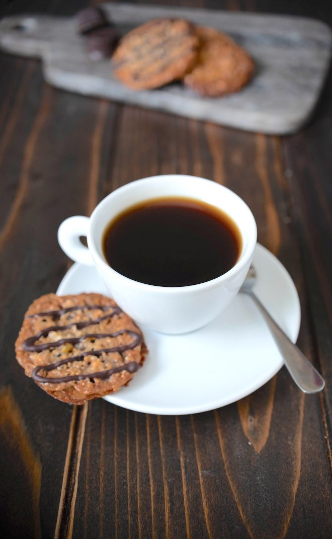 A Florentine cookie on the saucer of a cup of coffee
