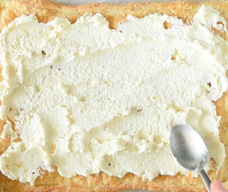 Ricotta mix is spread onto the baked puff pastry