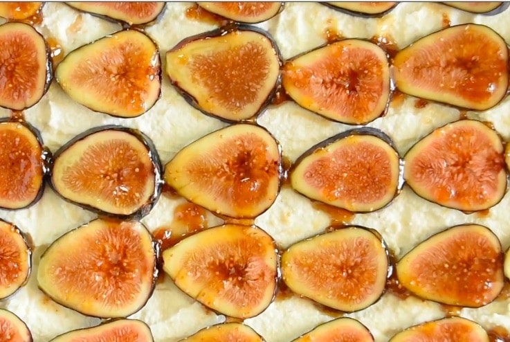 Fig preserves are brushed all over the fig slices
