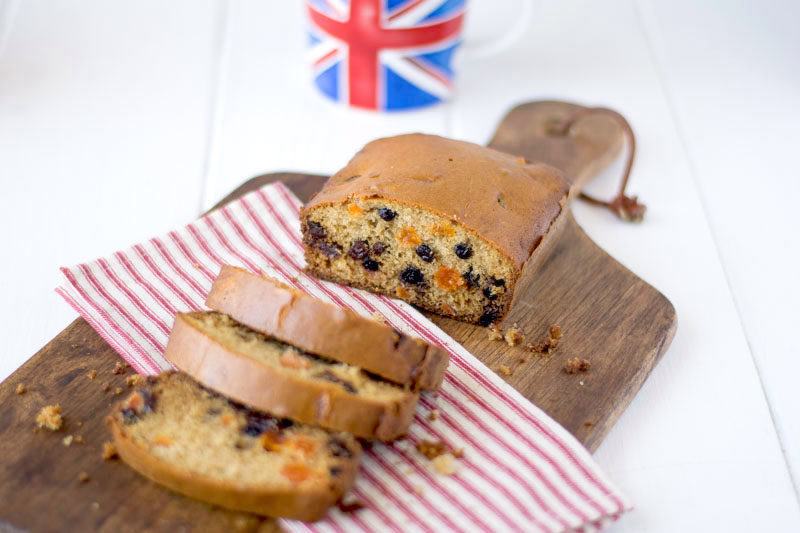 Fruity tea cake is the perfect accompaniment to a nice hot cup of tea. Dried fruit is soaked in tea with fresh orange zest then added to a simple cake batter and baked.