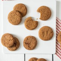 A selection of Ginger Snaps a.k.a Ginger Nuts on a white square plate