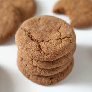 A tall stack of Ginger snaps ginger nuts cookies on a white plate